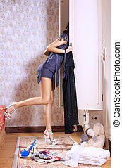 woman near sliding-door wardrobe - young woman near...