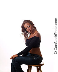 Young woman of mixed ethniciity sitting on stool