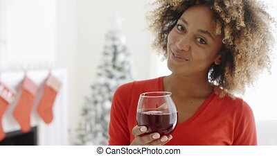 Young woman offering a Christmas toast