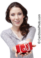 Young woman offers a present