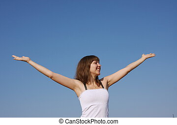 woman on a background blue sky