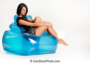 Young Woman On A Blue Inflatable Armchair