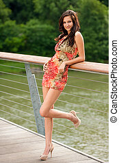 young woman on a bridge