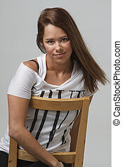 Young woman on a chair