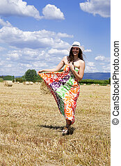 Young woman on a field.