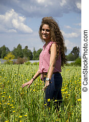 Young woman on a field of flowers
