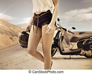 Young woman on a motorbike journey