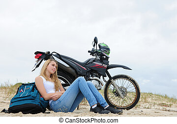 young woman on a road-trip with her motorbike