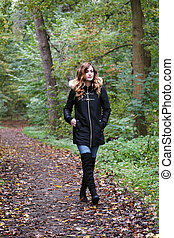 young woman on a solitary forest walk