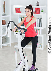 young woman on a stepper machine