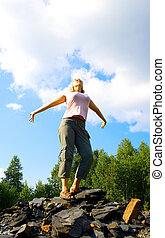 young woman on a stony hill 2