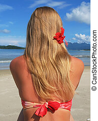 Young woman on a tropical beach of Langkawi island, Malaysia
