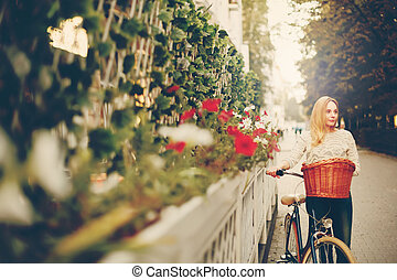 Young woman on a vintage bicycle in the city