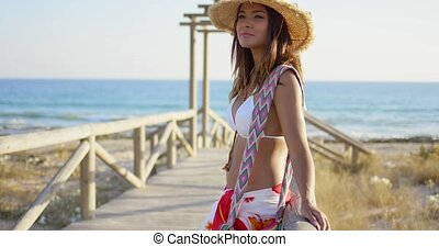 Young woman on a wooden beachfront promenade - Pretty young...
