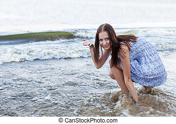 Young woman on background waves