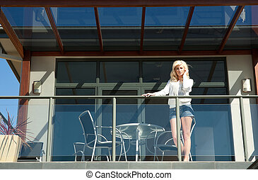 young woman on balcony