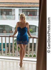 Young woman on balcony in lingerie