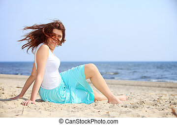young woman on beach summer holiday