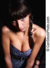 young woman on black background.