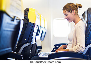 Young woman on board of an airplane