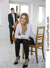 Young woman on chair smile on camera