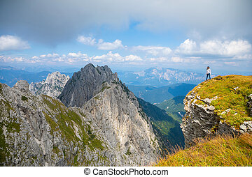 Young woman on cliff in Mangart saddle, Slovenia - Young...