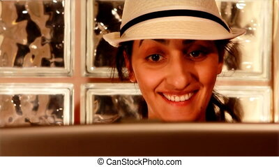 young woman on computer laughing