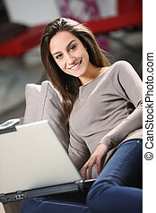 Young Woman on Couch with Laptop
