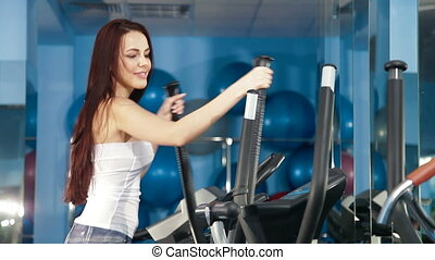 Woman On Cross Trainer At The Gym