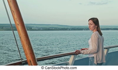 Young woman on cruise ship at sunrise