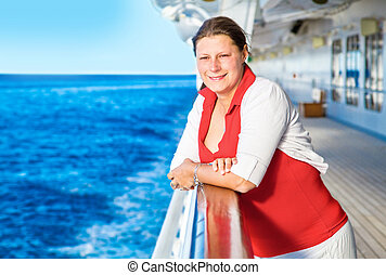 Young woman on cruise ship deck