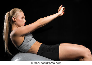 Young woman on fitness ball