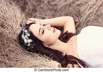 young woman on hay