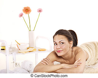Young woman on massage table in beauty spa. - Young...