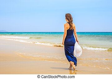 Young woman on ocean beach