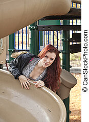 Young Woman on Playground Equipment