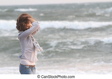 young woman on sea background