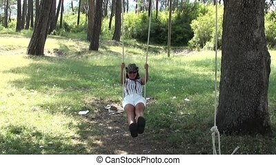 Young woman on seesaw