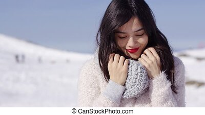 Young woman on ski slope with cozy sweater - Portrait of...