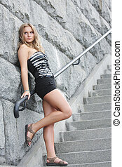 Young woman on staircase