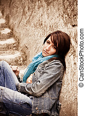 Young woman on stone stairs