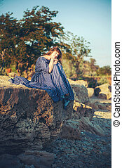 young woman on stone