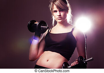 young woman on studio doing her workout