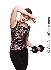 young woman on studio isolated white background doing her workout welghtlifting dumbbel