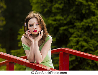 Young woman on the bridge