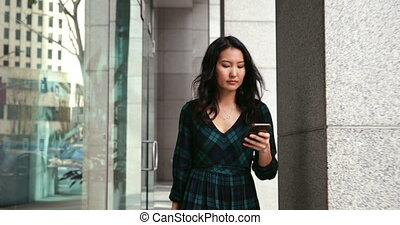 Young woman on the go in the city