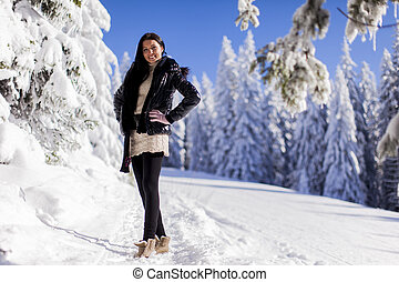 Young woman on the mountain in winter