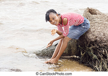 young woman on the of the lagoon.