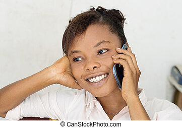 young woman on the phone smiling