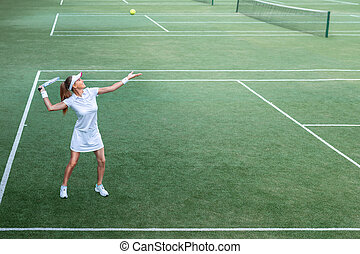 Young woman on the tennis court